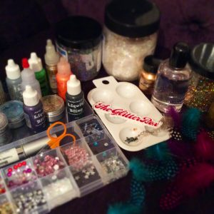 The glitterbox, face painting, kit, feathers, jewels, makeup, artistry, equipment, products, glitter, glamour